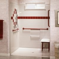 Wheelchair accessible bathroom shower with red colour accent tiling.